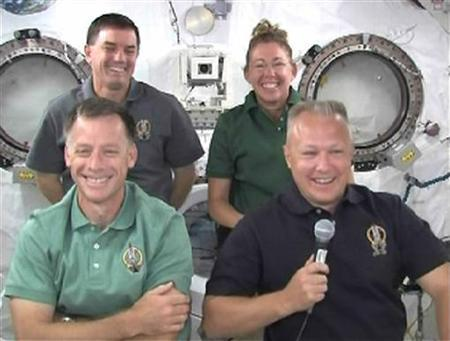 The space shuttle Atlantis crew (L-R) Commander Chris Ferguson, Rex Walheim, Sandy Mangus and Doug Hurley answer questions during a crew news conference from the International Space Station in this image from NASA TV July 13, 2011. REUTERS/NASA TV/Handout