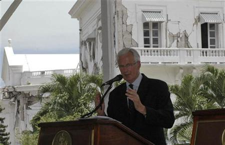 European Internal Market Commissioner Michel Barnier speaks during a news conference at the destroyed national place in Port-au-Prince July 28, 2010. REUTERS/ St-Felix Evens