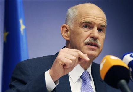 Greece's Prime Minister George Papandreou addresses a news conference at the end of an European Union leaders summit in Brussels June 24, 2011. REUTERS/Eric Vidal
