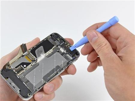 A connector on the logic board is removed from the iPhone 4 during iFixit's teardown of the phone in San Luis Obispo, California June 22, 2010. REUTERS/iFixit/Handout