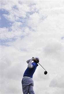 Rory McIlroy of Northern Ireland tees off on the second hole during the final round of the British Open golf championship at Royal St George's in Sandwich, southern England July 17, 2011. REUTERS/Toby Melville