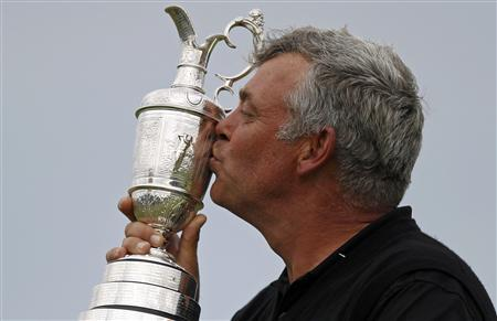 Darren Clarke of Northern Ireland kisses the Claret Jug after winning the British Open golf championship at Royal St George's in Sandwich, southern England July 17, 2011. REUTERS/Eddie Keogh