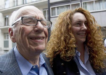 News Corporation CEO Rupert Murdoch leaves his flat with Rebekah Brooks, Chief Executive of News International,  in central London July 10, 2011. REUTERS/Olivia Harris