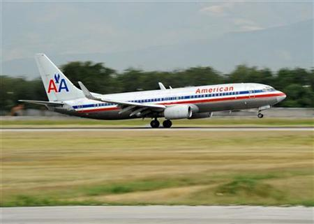 An American Airlines jet touches down at the airport in Port-au-Prince February 19, 2010. REUTERS/U.S. Navy/Oscar Sosa/Handout