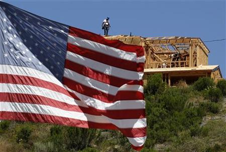 Workers build new homes on a hilltop in Carlsbad, California May 27, 2011. REUTERS/Mike Blake