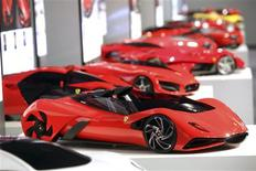 "<p>The Ferrari ""Eternity"" (front) is seen with others concept scale models in Maranello July 19, 2011. REUTERS/Ferrari Press Office/Handout</p>"