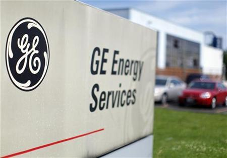 The sign at the entrance to a General Electric Co. facility is seen in Medford, Massachusetts July 17, 2009. REUTERS/Brian Snyder