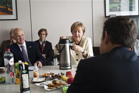 German Chancellor Angela Merkel, Greece's Prime Minister George Papandreou and France's President Nicolas Sarkozy attend a meeting in Brussels July 21, 2011. REUTERS/Bundesregierung/Steffen Kugler/Pool