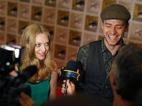 "<p>Cast members Justin Timberlake (R) and Amanda Seyfried speak during an interview for their upcoming motion picture ""In Time"" at Comic Con in San Diego, California July 21, 2011. REUTERS/Mike Blake</p>"