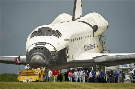 Space shuttle Atlantis (STS-135) is rolled over to the Obiter Processing Facility (OPF) shortly after landing at NASA's Kennedy Space Center Shuttle Landing Facility (SLF), completing its 13-day mission to the International Space Station (ISS) and the final flight of the Space Shuttle Program, in Cape Canaveral, Florida, July 21, 2011.REUTERS/NASA/Bill Ingalls/Handout