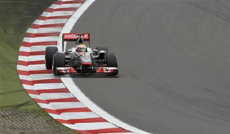 McLaren Formula One driver Lewis Hamilton of Britain takes a corner during the German F1 Grand Prix at the Nuerburgring circuit, July 24, 2011. REUTERS/Alex Domanski