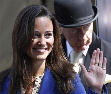 Pippa Middleton waves as she leaves The Goring hotel, in central London April 30, 2011. REUTERS/Suzanne Plunkett