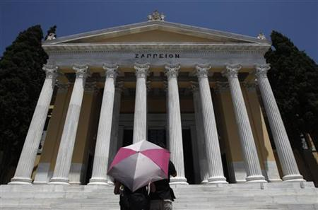 Tourists stand in front of Zappeion mansion in Athens July 27, 2011. REUTERS/John Kolesidis