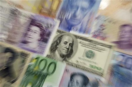 Arrangement of various world currencies including Chinese Yuan, Japanese Yen, US Dollar, Euro, British Pound, Swiss Franc are pictured in Warsaw January 26, 2011. REUTERS/Kacper Pempel