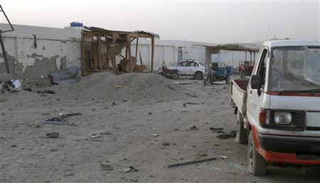 Damaged vehicles are seen inside the government compound in Uruzgan province July 28, 2011. REUTERS/Stringer