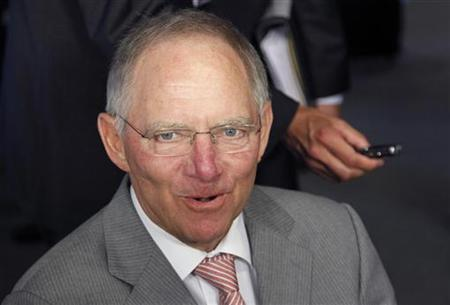 German Finance Minister Wolfgang Schaeuble talks to the media as he arrives at a euro zone finance ministers meeting in Luxembourg June 20, 2011. REUTERS/Francois Lenoir