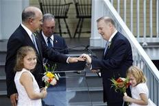 <p>Jonathan Mintz (2nd L), New York City's consumer affairs commissioner, has a wedding ring placed on his finger by John Feinblatt (R), a chief adviser to the mayor, as they stand with daughters Maeve (L) and Georgia during a marriage ceremony presided by New York City Mayor Michael Bloomberg (C) at Gracie Mansion in New York July 24, 2011. REUTERS/Lucas Jackson</p>