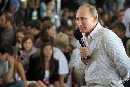 Russian Prime Minister Vladimir Putin answers questions from the audience during his visit to the summer camp of the pro-Kremlin youth group ''Nashi'' at lake Seliger, some 400km (248miles) north of Moscow, August 1, 2011. REUTERS/Mikhail Metzel/Pool