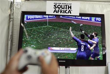 A person plays the EA Sports 2010 FIFA World Cup South Africa video game in Los Angeles, May 12, 2010. REUTERS/Lucy Nicholson