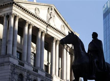 A statue is seen outside the Bank of England in the City of London February 8, 2011. REUTERS/Chris Helgren