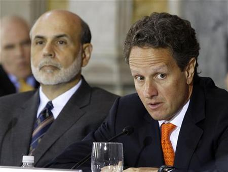 U.S. Treasury Secretary Timothy Geithner (R) talks next to Chairman of the Federal Reserve Ben Bernanke (L) at a Financial Stability Oversight Council meeting in the Cash Room in the Treasury Department in Washington, July 18, 2011. REUTERS/Larry Downing