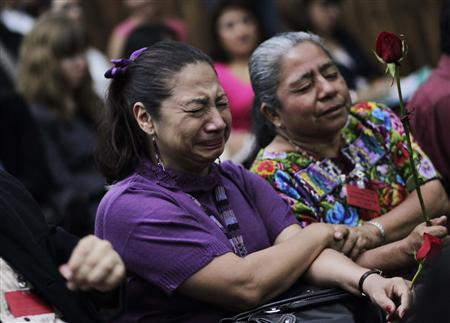 A woman reacts after hearing the sentence of four former soldiers convicted of war crimes at the Supreme Court in Guatemala City, August 2, 2011. REUTERS/Jorge Dan Lopez