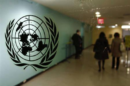 The United Nations logo is displayed on a door at U.N. headquarters in New York February 26, 2011. REUTERS/ Joshua Lott/Files