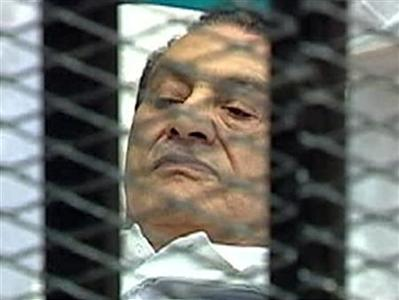 Former Egyptian President Hosni Mubarak is seen in the courtroom for his trial at the Police Academy in Cairo, August 3, 2011. REUTERS/Egypt TV via Reuters TV