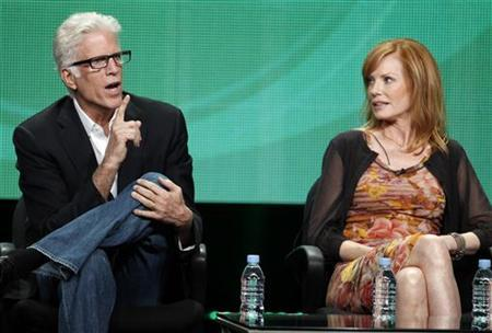 Ted Danson (L) and Marg Helgenberger, cast members of 'CSI Crime Scene Investigation', speak during a panel discussion at the CBS Television Network's 2011 Summer Television Critics Association Press Tour in Beverly Hills, California August 3, 2011. REUTERS/Fred Prouser