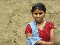 <p>Sapna Meena, 15, stands in front of her house in the remote Indian village of Badakakhera in Bhilwara District in the western state of Rajasthan, in this June 22, 2011 file photo. In April, her family wanted her to become a child bride -- an illegal yet common practice in this part of India. With the support of the local authorities, she convinced her family to stop the wedding plans and became a role model for other girls in the village who also resisted child marriage. India is considered a child marriage 'hotspot', with 45 percent of women married before the legal age of 18, according to the International Centre for Research on Women. REUTERS/TRUSTLAW/Nita Bhalla/Files</p>
