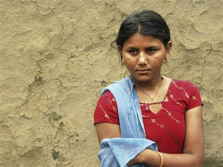 Sapna Meena, 15, stands in front of her house in the remote Indian village of Badakakhera in Bhilwara District in the western state of Rajasthan, in this June 22, 2011 file photo. REUTERS/TRUSTLAW/Nita Bhalla/Files