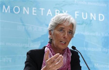 IMF managing director Christine Lagarde holds a news briefing at the International Monetary Fund headquarters in Washington, July 6, 2011. REUTERS/Kevin Lamarque