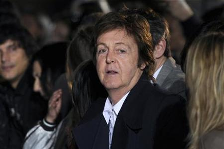 Singer Paul McCartney attends the fashion show designed by his daughter Stella McCartney at her Fall-Winter 2011/2012 women's collection during Paris Fashion Week March 7, 2011. REUTERS/Gonzalo Fuentes