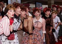 """<p>Lucille Ball look-a-likes pose at the premiere of the new film """"Rat Race"""" in Los Angeles July 30, 2001. REUTERS/Fred Prouser</p>"""