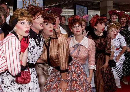 Lucille Ball look-a-likes pose at the premiere of the new film ''Rat Race'' in Los Angeles July 30, 2001. REUTERS/Fred Prouser