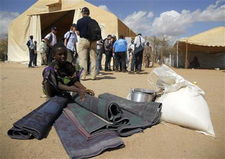 A newly arrived Somali refugee collects non-consumable welfare items from the Office of the United Nations High Commissioner for Refugees (UNHCR) compound at Dagahaley refugee camp in Dadaab, near the Kenya-Somalia border August 3, 2011. REUTERS/Daud Yussuf