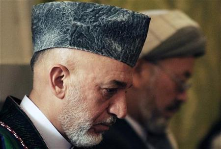 Afghanistan's President Hamid Karzai attends the funeral ceremony for his younger brother Ahmad Wali Karzai at the presidential palace in Kabul in this July 15,2011 file photo.REUTERS/Massoud Hossaini/Pool