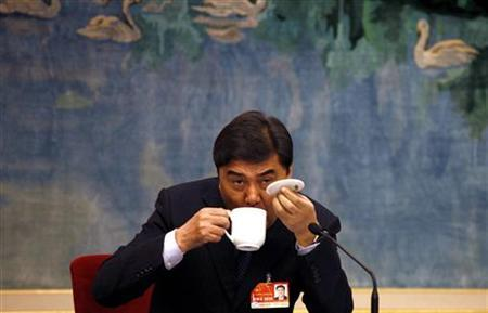 Top Chinese official Zhang Chunxian, appointed Xinjiang's Communist Party chief, drinks a cup of tea before the meeting between the Xinjiang provincial delegation and representatives from the National People's Congress (NPC) in the Great Hall of the People in Beijing March 8, 2011. REUTERS/David Gray