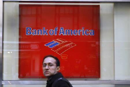 Pedestrians walk past a Bank of America sign on the street in New York March 8, 2011. REUTERS/Lucas Jackson/Files