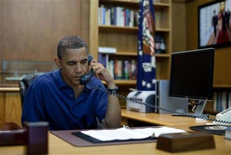 U.S. President Barack Obama holds a conference call from Camp David, Maryland, in this August 6, 2011 photo release. A NATO helicopter crashed during a battle with the Taliban in Afghanistan, killing 31 U.S. soldiers and seven Afghans, the Afghan president said on Saturday, the deadliest single incident for foreign troops in 10 years of war. According to the White House, Obama held a briefing on the tragedy in Afghanistan with Defense Secretary Leon Panetta, Admiral Mike Mullen, Chairman of the Joint Chiefs of Staff, National Security Advisor Tom Donilon and Chief of Staff Bill Daley. REUTERS/Pete Souza/The White House/Handout