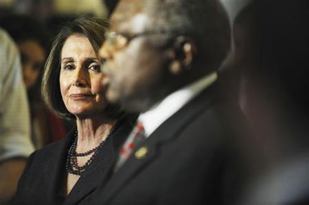 US House Speaker Nancy Pelosi (D-CA) (L) listens to Rep. James Clyburn (D-SC) (C) as she holds a news conference after a Democratic Caucus meeting on Capitol Hill in Washington, November 17, 2010. REUTERS/Jonathan Ernst