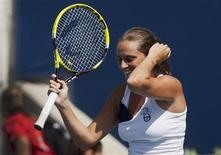 <p>Roberta Vinci of Italy celebrates defeating Caroline Wozniacki of Denmark during their match match at the Rogers Cup women's tennis tournament in Toronto, August 10, 2011. REUTERS/Mark Blinch</p>