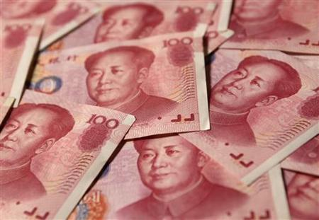 Yuan banknotes are seen in this illustrative photograph taken in Beijing September 19, 2010. REUTERS/Petar Kujundzic