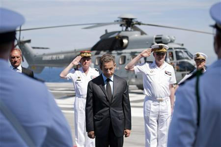 France's President Nicolas Sarkozy reviews the troops on the deck of the aircraft carrier Charles de Gaulle in the port of Toulon, August 12, 2011. REUTERS/Bertrand Langlois/Pool