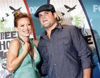 <p>Actress and singer Hilary Duff and hockey player Mike Comrie pose in the press room at the Teen Choice 2010 Awards in Los Angeles August 8, 2010. REUTERS/Jason Redmond</p>