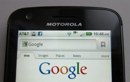 A Motorola Droid phone is seen displaying the Google search page in New York August 15, 2011. REUTERS/Brendan McDermid