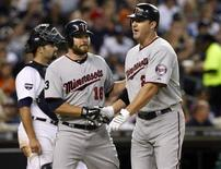 <p>Minnesota Twins Jim Thome (R) is greeted at home-plate by teammate Jason Kubel after hitting his 599th career home-run during the sixth inning of their MLB American League baseball game against the Detroit Tigers in Detroit, Michigan August 15, 2011. REUTERS/Rebecca Cook</p>
