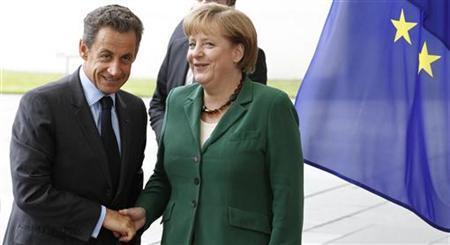 German Chancellor Angela Merkel (R) welcomes France's President Nicolas Sarkozy before talks in Berlin, July 20, 2011. REUTERS/Tobias Schwarz