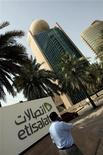 <p>A man talks on his mobile phone as he walks past the Etisalat Telecommunications building in Dubai August 2, 2010. Dubai is monitoring social media sites for signs of attempts to organize protests or strikes, a police official said on Wednesday, citing the large foreign laborer population as a concern. REUTERS/Mosab Omar</p>