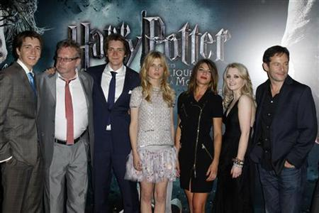 (L-R) Cast members Oliver Phelps, Mark Williams, James Phelps, Clemence Poesy, Natalia Tena, Evanna Lynch and Jason Isaacs arrive for the premiere of the film ''Harry Potter and the Deathly Hallows: Part 2'' at Bercy in Paris, July 12, 2011. REUTERS/Benoit Tessier
